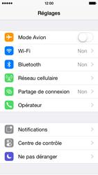 Apple iPhone 5s (iOS 8) - Aller plus loin - Désactiver les données à l'étranger - Étape 3